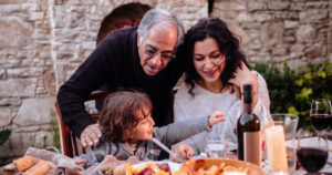 Italian family sitting at table
